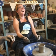 have a go on the potter's wheel is hilarious fun at eastnor pottery