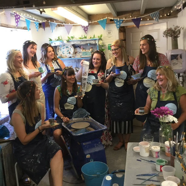 pottery hen party team photograph in the pottery studio at eastnor pottery