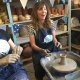 young mums enjoy making pottery on the potters wheel in the summer at eastnor pottery