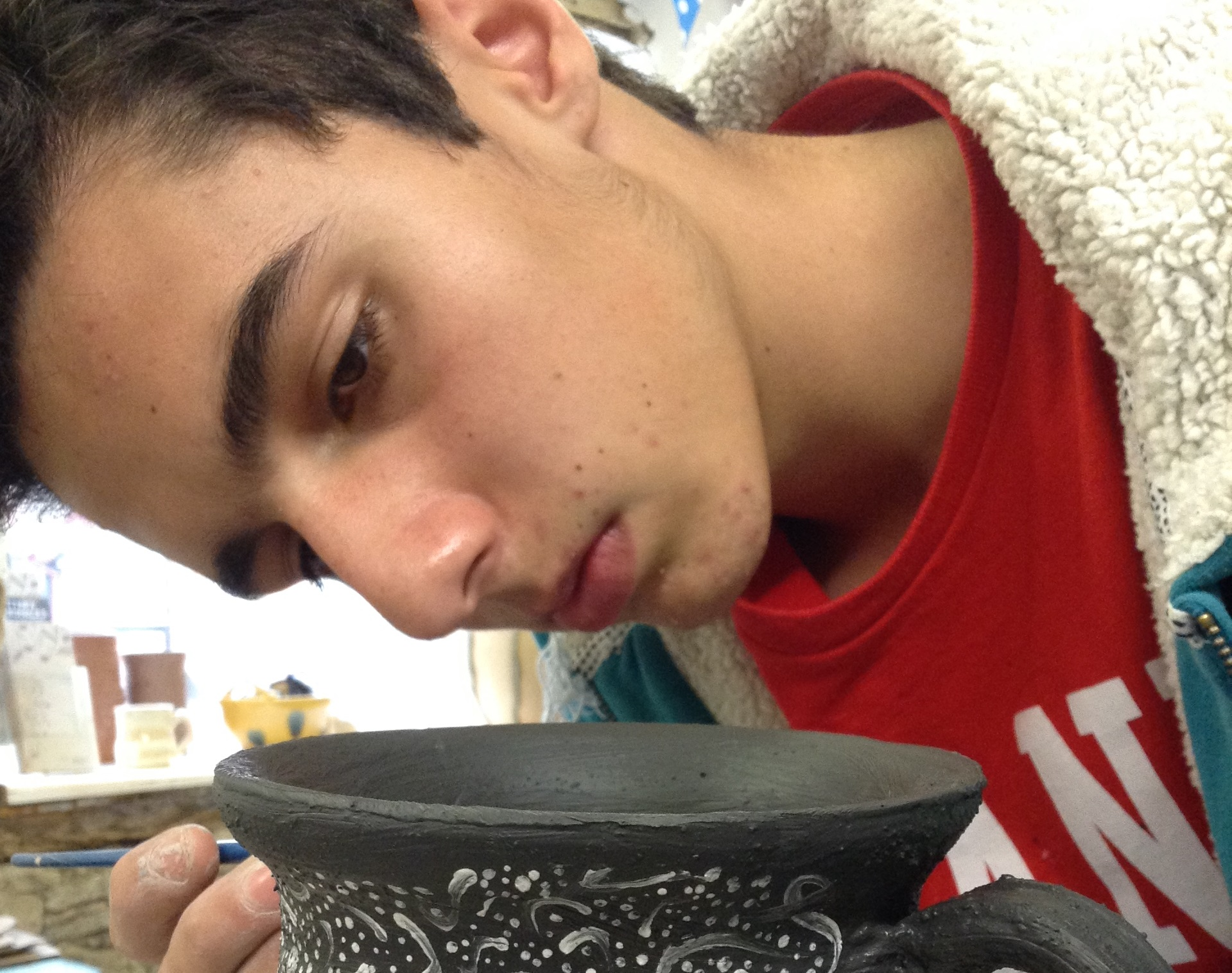 A level student working with Eastnor pottery and the flying potter to create a clay mug