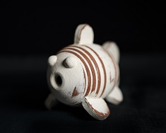 interactive ceramic fish designed for water play by artist jon williams