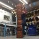 Aimee from eastnor pottery herefordshire displaying terracotta totem pole created by all the children at meadows first school in bromsgrove