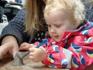 child and mother making clay unicorn at countrytastic with eastnor pottery