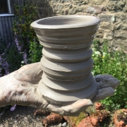 clay pot in the hand made at eastnor pottery