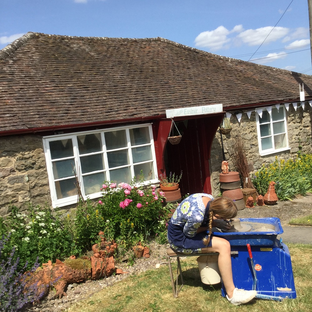 sarah monk from eastnor pottery in the garden