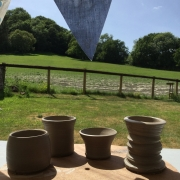 clay pots drying in the potting tent marquee at eastnor pottery