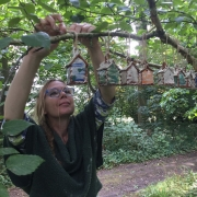 herefordshire potter sarah monk hanging her ceramic bug houses at hellens garden festival