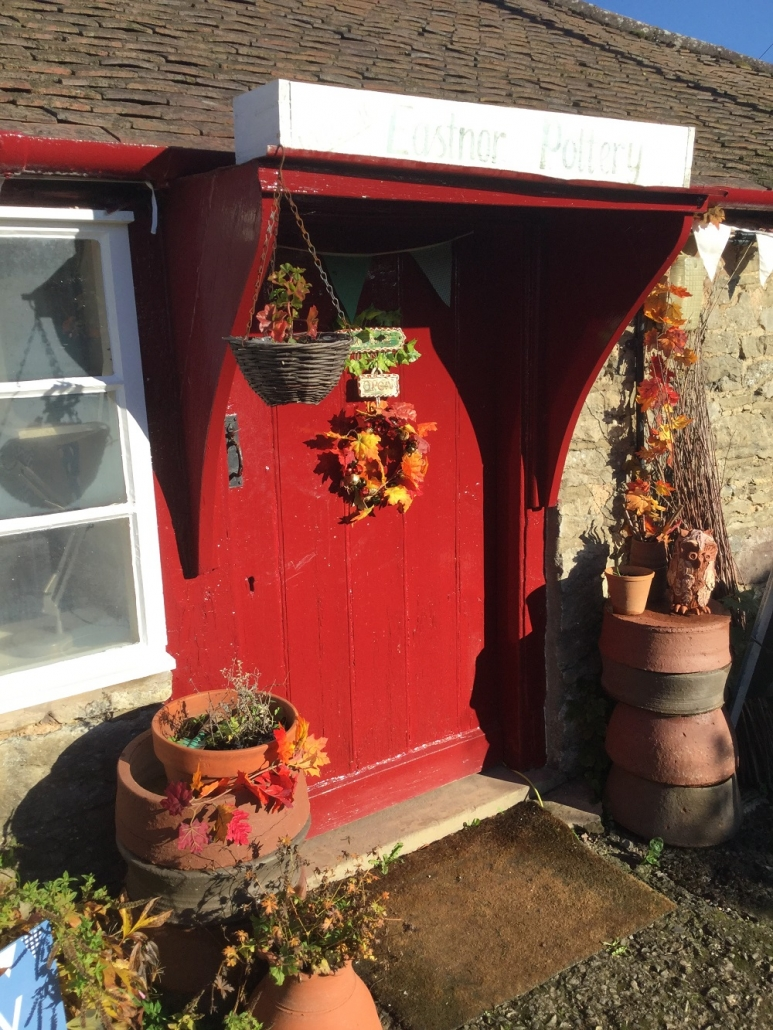 Autumnal front door at eastnor pottery