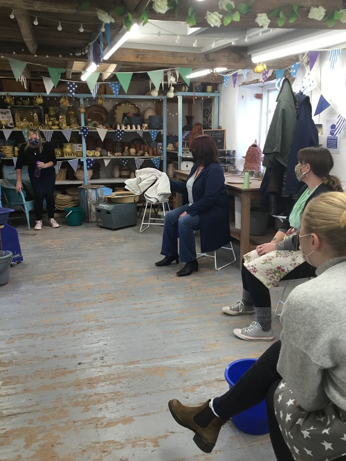 Roger oats design staff wotching pottery demo on an away day at eastnor pottery