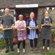 family pose with their freshly thrown pots outside eastnor pottery