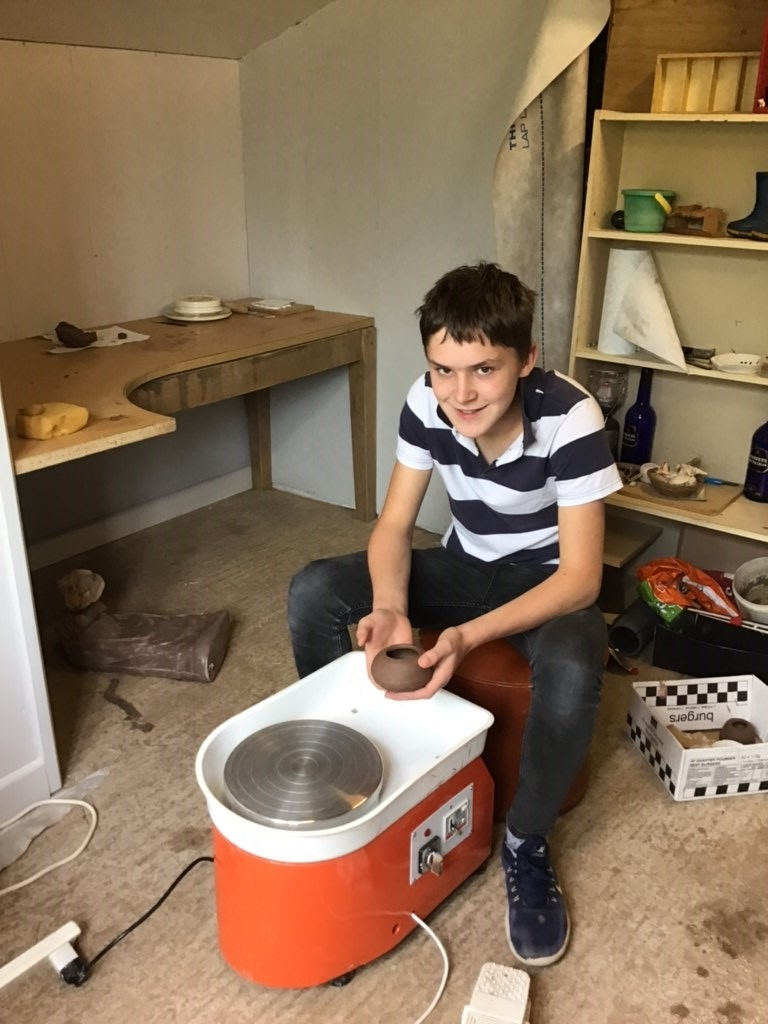 young pottery enthusiast and his shiny new potter's wheel
