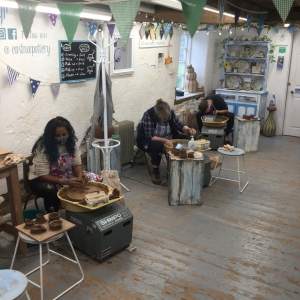socially distanced pottery participants celebrating a birthday at eastnor pottery