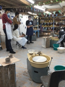 pottery workshop participant centering the clay at eastnor pottery