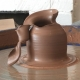 beautifully hand thrown pot made on the potter's wheel and then accidently torn in an artisitic fashion