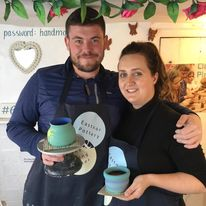 Intro to the potter's wheel participants show off their painted pots at eastnor pottery and the flying potter