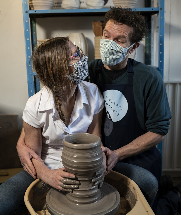 Herefordshire potters Jon Williams and Sarah Monk reenact the film ghost on the potter's wheel