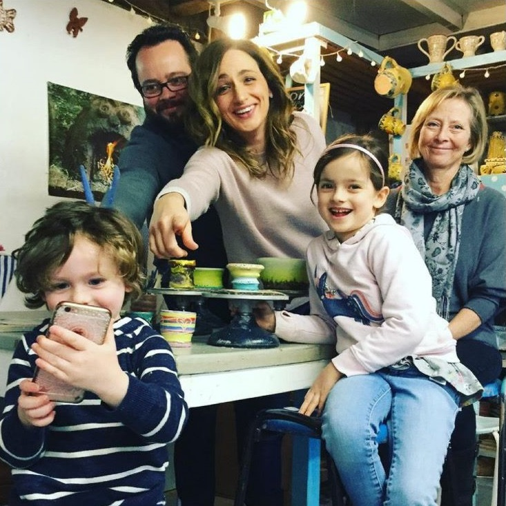 family pose for a photograph at eastnor pottery