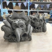 two clay monsters at eastnor pottery created on using the coil pot technique
