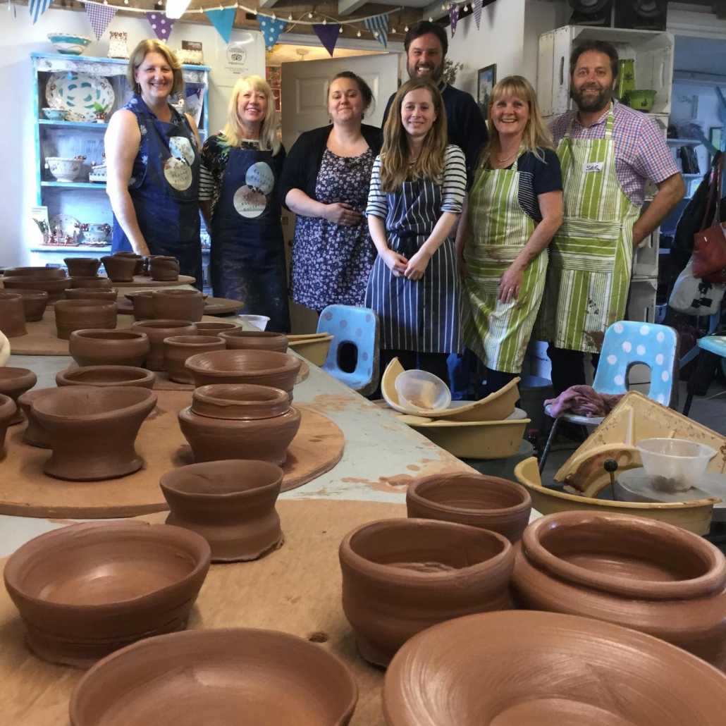 wet terracotta pots made by potter's wheel course participants at eastnor pottery