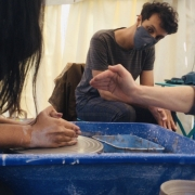 masked pottery classes taking place in the potting tent at eastnor pottery herefordshire