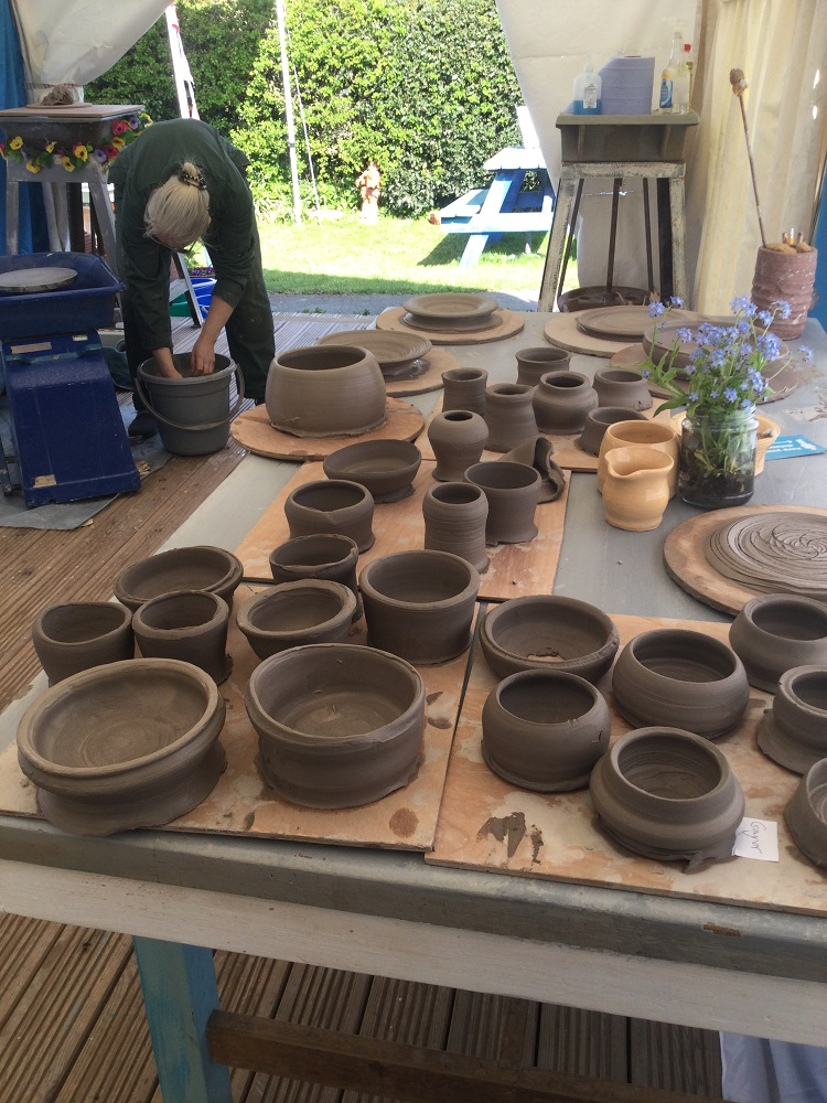 cleaning the wheels and tidying up after day potter's wheel course