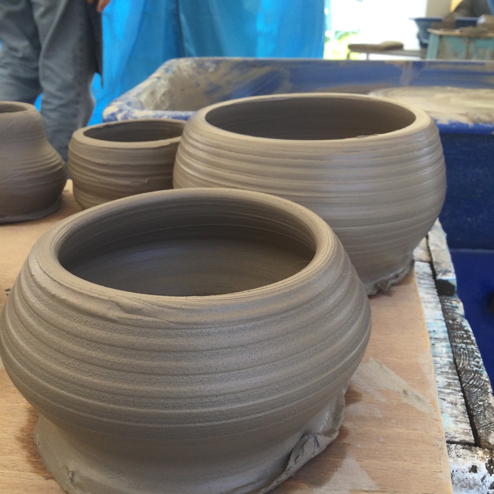 freshly made pots made on the potter's wheel by course participants at eastnor pottery herefordshire