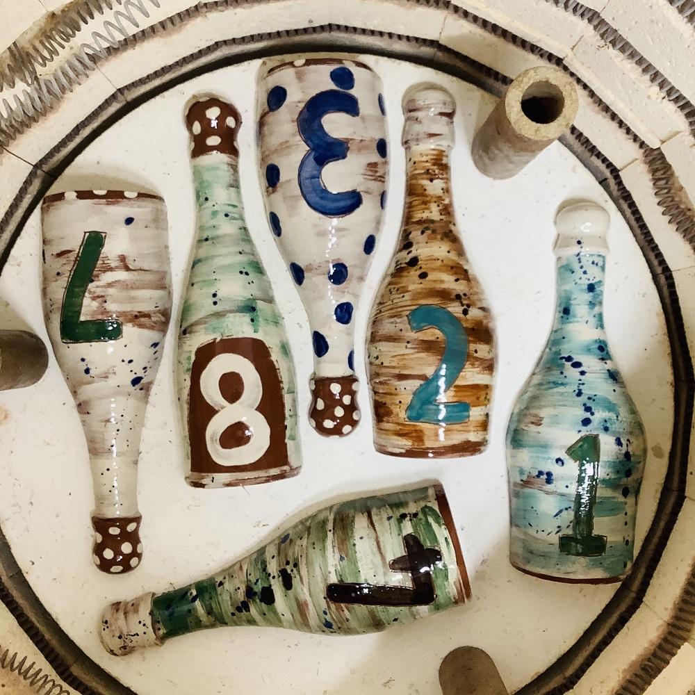 terracotta bottles post firing painted and glazed inside the kiln