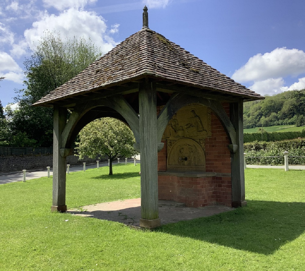 eastnor village triangle wooden with brick roof