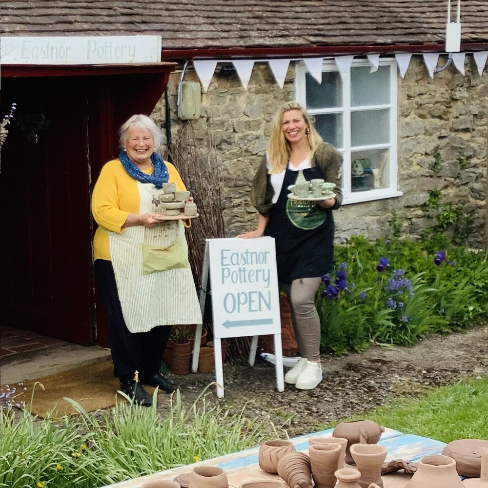 mother and daughter attending weekend pottery course