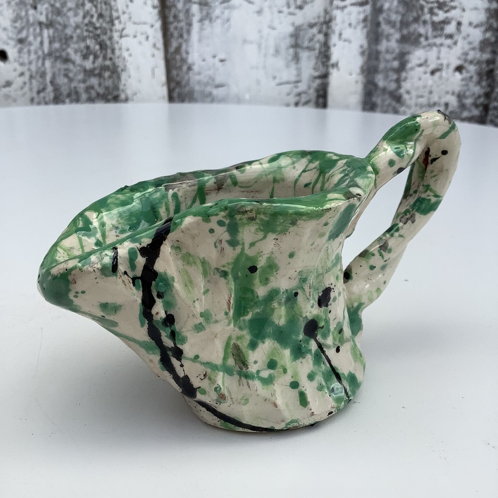 small jug painted white with green and blue splatters