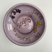 purple pot from birds eye eye with inscription and flowers quoting the bible