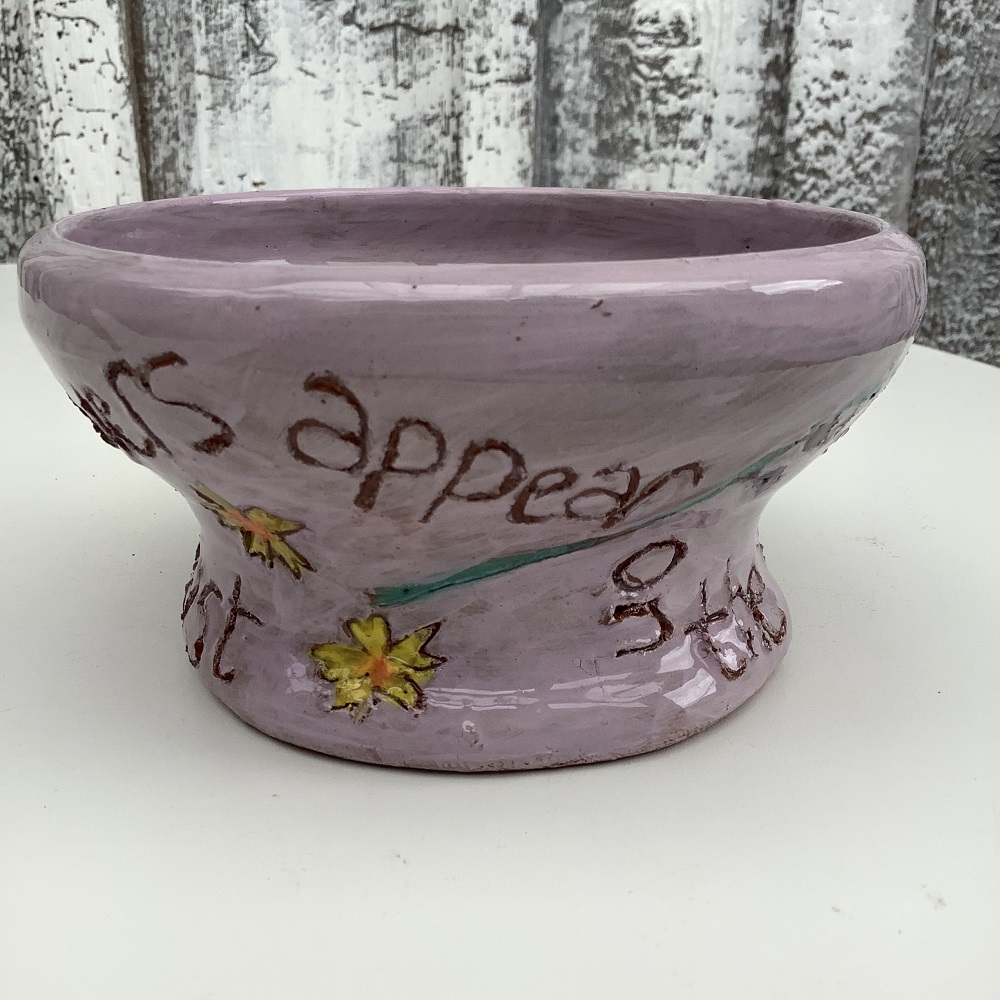 purple pot with inscription and flowers quoting the bible