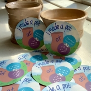 round sticker containing text that reads 'I made a pot at Eastnor Pottery' scattered surrounding hand thrown pots