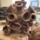 a ball of freshly thrown pots assembled into a sculpture