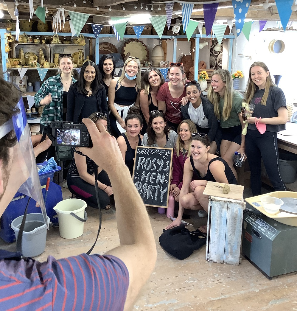 large hen party group enjoyed making pots on the potters wheel at eastnor pottery